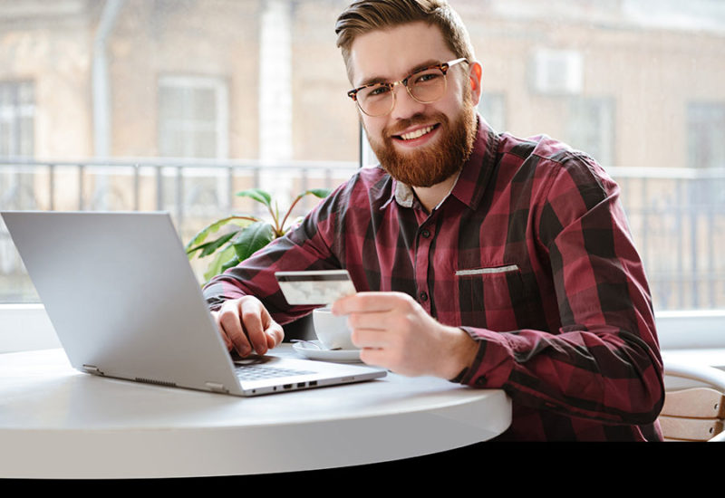 Male making purchase via computer