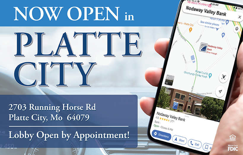 Hand holding smart phone displaying map to Nodaway Valley Bank Platte City
